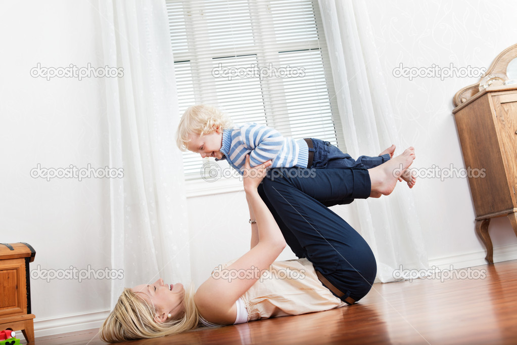 Happy mother playing with her cute loving baby at home — Stock Photo #6585681