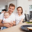 Family Portrait at Table - Stock Photo