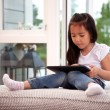 Stock Photo: Child Using Digital Tablet