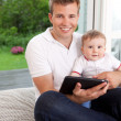 Father and Son with Digital Tablet — Stock Photo #6604730