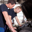Постер, плакат: Mechanics Team with Diagnostics Equipment