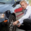 Business Man Tire Change - Stock Photo