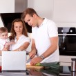 Stock Photo: Family in Kitchen Preparing Meal