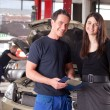 Mechanic with Customer - Foto Stock