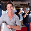 Mechanic Man with Air Wrench - Stock Photo