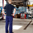 Mechanic Looking at Car - Stock Photo