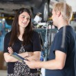 Female Customer in Mechanic Shop - Stock Photo