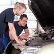 Mechanics in Auto Repair Shop - Stock Photo