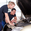 Stock Photo: Mechanics in Auto Repair Shop