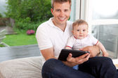 Father and Son with Digital Tablet — Stock Photo