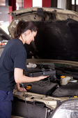Woman Mechanic with Engine Diagnostics Tool — Stock Photo
