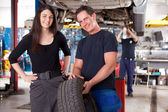 Customer with Mechanic and Tire — Stock Photo
