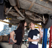 Mechanic Showing Customer Repairs — Stock Photo