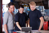 Mechanics with Laptop — Stock Photo