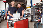 Portrait of smiling mechanics — Stock Photo