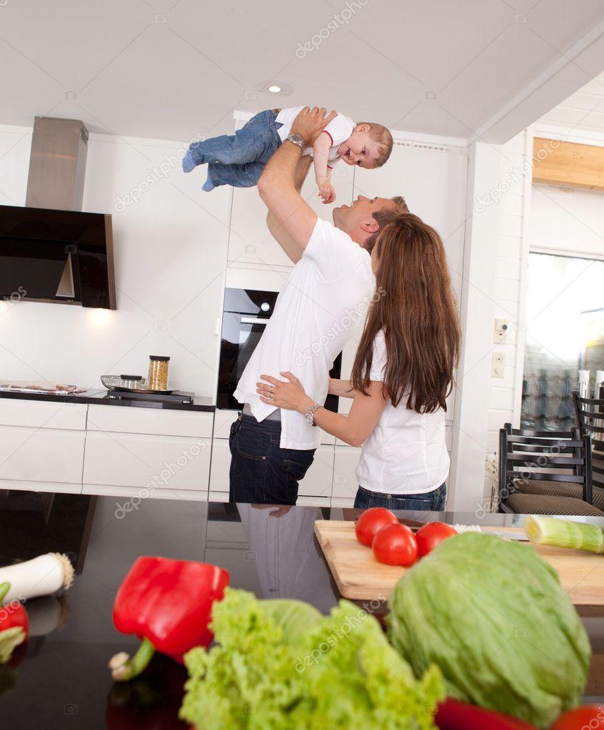 playful family in kitchen  stock photo © simplefoto, Kitchen design