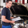 Mechanic with Service Report — Stock Photo #6610133