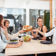 Friends having food and drink at home — Stock Photo