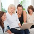 Group of friends with laptop — Stock Photo