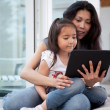 Mother and Daugther with Digital Tablet - Stock Photo