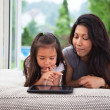 Stock Photo: Mother and Daughter with Digital Tablet