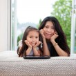 Mother and Daughter with Digital Tablet - Photo