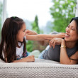 Playful mother and daughter - Foto de Stock