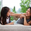 Stock Photo: Playful mother and daughter