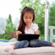 Young Girl with Digital Tablet — Stock Photo