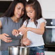 Mother and Daughter Baking - Stock Photo