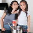 Mother and daughter in kitchen — Stock Photo