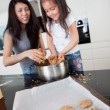 Mother and Daughter Baking Cookies - Stock Photo