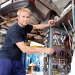Mechanic Working in Garage - Zdjęcie stockowe