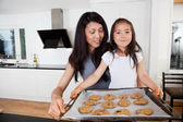 Proud Child with Raw Cookies — Stockfoto