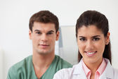 Female doctor with colleague standing behind — Stock Photo
