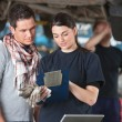 Female Mechanic Explaing Repairs to Client — Stock Photo #6620038
