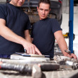 Mechanics Looking at Work Order — Stock Photo #6620298