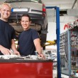 Mechanics at an auto shop — Stock Photo #6620413