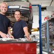 Stock Photo: Mechanics at an auto shop