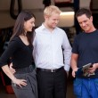Happy Customer Couple with Mechanic - Stock Photo