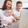Family with Laptop Computer — Stock Photo #6620999