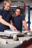 Mechanics Looking at Work Order — Stock Photo