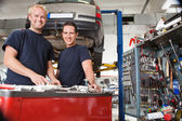 Mechanics at an auto shop — Stock Photo