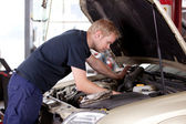 Mechanic Fixing Car — Stock Photo