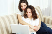 Couple on a couch, browsing — Stock Photo