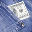 Dollars are in jeans pocket - Stock Photo
