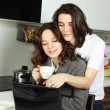 happy couple in their kitchen — Stock Photo #5453312