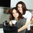 Stock Photo: happy couple in their kitchen