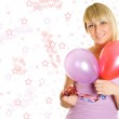 Close-up young woman with colorful balloons — Stock Photo