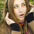 Young attractive woman with headphones - Stock Photo